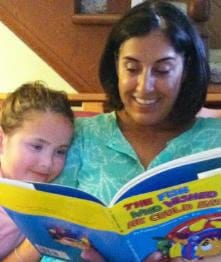 Parent reading The Fish book to child